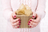 Present. Gift box. Woman holding small gift box with ribbon. - 179119016