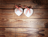 Two hearts and wooden background. - 179124665