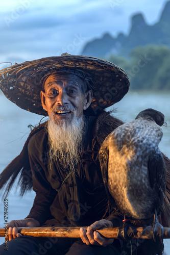 Fotobehang Guilin Fisherman of Guilin, Li River and Karst mountains during the blue hour of dawn,Guangxi China