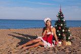 girl Christmas tree in the South on the beach - 179140891