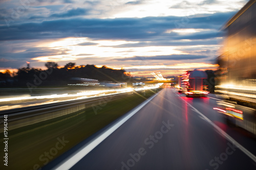 Foto op Canvas Nacht snelweg City evening lights, highway zoomed perspective blurred by high speed of the car.