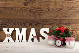 Christmas decorations. Christmas background. Watch, candle and Xmas text on wooden table. - 179157444