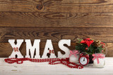 Christmas decorations. Christmas background. Watch, candle and Xmas text on wooden table. - 179157494