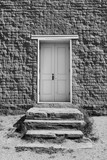 Steps and Wooden Door to Old Stone Church