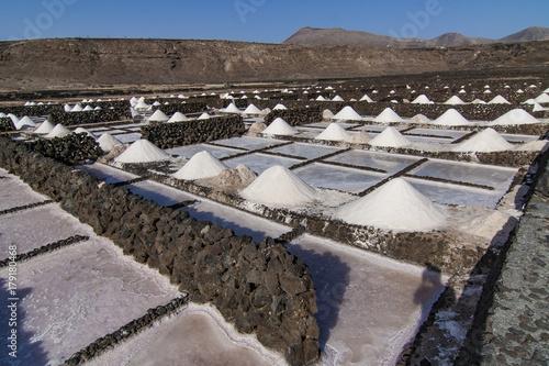 Foto op Canvas Canarische Eilanden Salt mine and piles in the old historic saline in Janubio