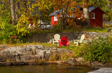 Red cottage on rocky shore - 179185645