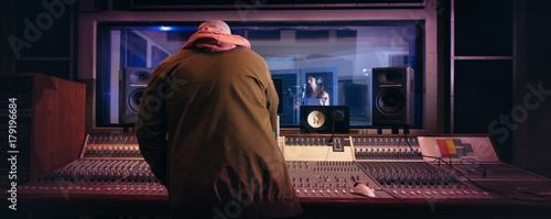 Fotobehang Muziek Musicians producing music in professional recording studio