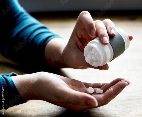 Foto op Plexiglas Apotheek Woman taking medicine