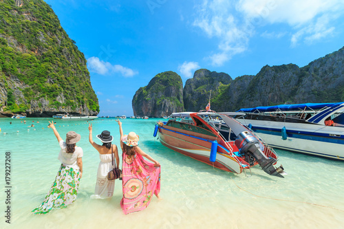 MAYA BAY, THAILAND - April  22, 2017: Crowds of sunbathing visitors enjoy a day trip boat ride to Maya Bay, one of the most beautiful beaches of Phuket province Thailand. © PRASERT