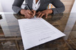 Businesswoman Holding Pen To Sign On Contract Paper