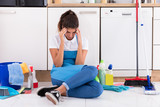Young Woman Sitting On Kitchen Floor - 179230267