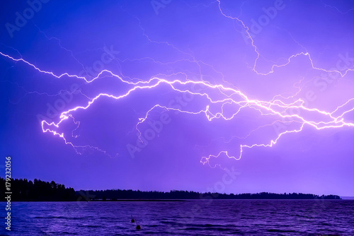 Foto op Canvas Violet Lightning, Stormy Skies with multiple lightning strikes