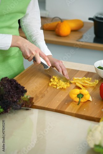 Fridge magnet Closeup of human hands cooking vegetables salad in kitchen on the glass  table with reflection