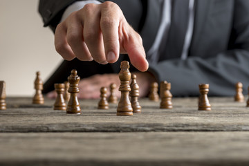 Businessman wearing business suit playing a game of chess © Gajus