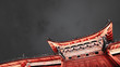 Traditional Chinese roof  in the Old Town of Lijiang at night, toned image with copy space, China.