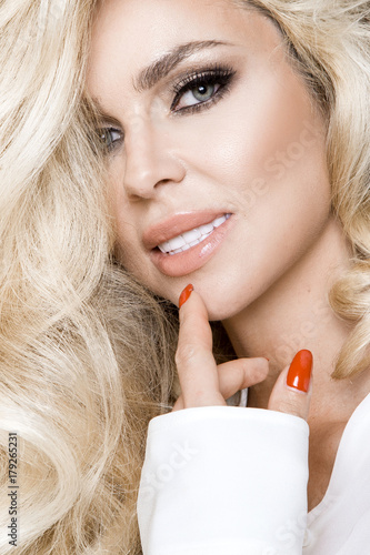Fotobehang Manicure Portrait of a beautiful, smiling woman with long blonde hair and white teeth