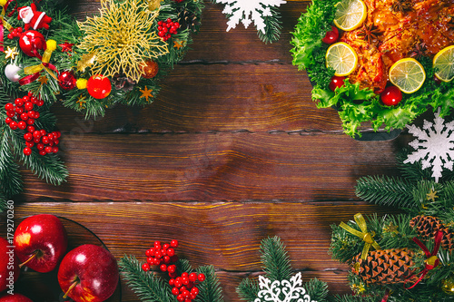 Christmas table dinner time with roasted meats decorated in Christmas style. Background thanksgiving. The concept of a family holiday, Beautiful delicious food. Frame with free space - 179270260
