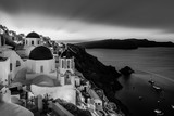 Black and white cityscape of Oia, traditional greek village with blue domes of churches, Santorini island, Greece at dusk. - 179271466