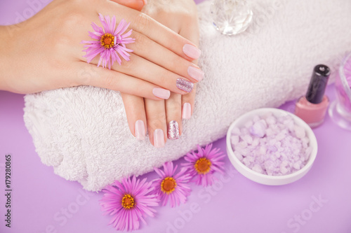 Aluminium Manicure Beautiful pink and silver manicure with flowers and spa essentials