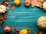 Moody green autumn background with pumpkin, apples, yellow leaves. Fall still life flat lay. Copy space frame - 179282609