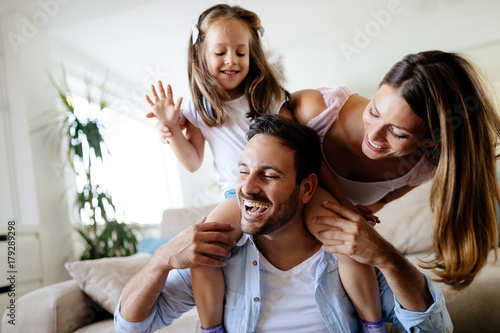 Happy family having fun times at home
