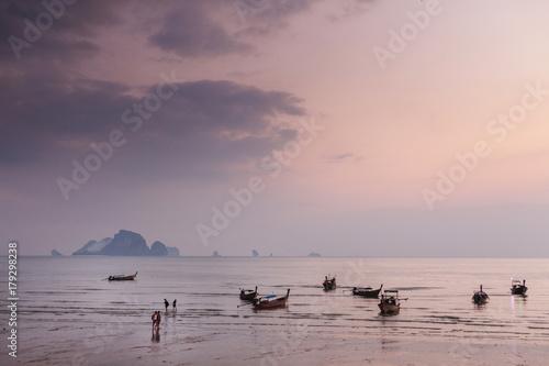 Fotobehang Thailand Ao Nang, Krabi province.Traditional thai boats at sunset beach.