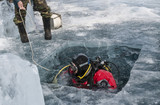 diver plunges into the hole in the ice of lake Baikal - 179300469