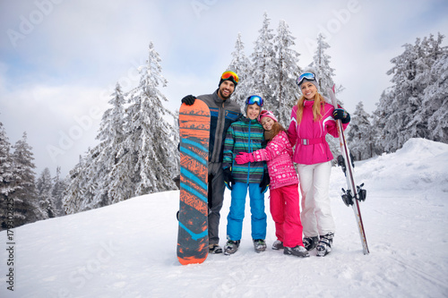 Happy family enjoying in winter vacations together