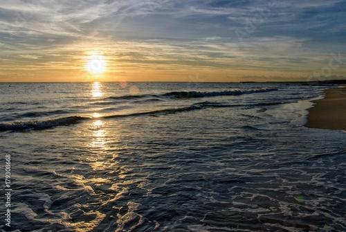 Fotobehang Zee zonsondergang Autumn in Menorca, Sunset in Son Bou. Balearic Islands, Spain