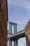 Brick wall buildings and Manhattan Bridge in Brooklyn New York City, United States