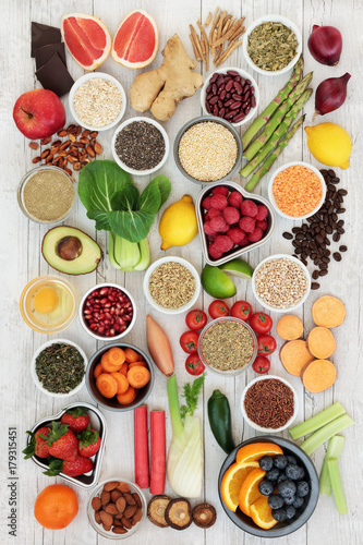 Diet super food  ingredients with herbs used as appetite suppressants, fruit, vegetables, nuts, seeds, grains cereals and legumes. Super foods high in antioxidants, anthocyanins, fibre and vitamins.