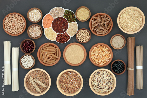 Fridge magnet Healthy dried macrobiotic food with soba and udon noodles, pulses, cereals, whole wheat pasta, seeds and cereals, high in protein, omega 3,  antioxidants  and vitamins on rustic background,