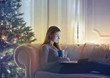 Beautiful woman relaxing on the sofa at Christmas