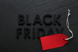 Black Friday text with red sale tag on slate background - 179328021