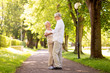 happy senior couple dancing at summer park