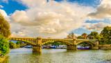 Boats moored by Twickenham Bridge spanning over the river Thames, London U.K - 179335695