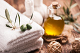 Olive oil bar soap with towels on wooden background - 179336699