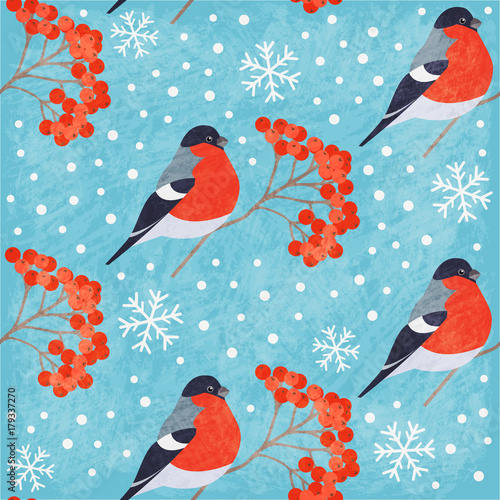 Winter vintage seamless pattern with bullfinch, rowan and snowflakes on blue background. Shabby texture. Vector illustration