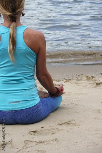 yoga lotus position on beach background copy space  calm beach ocean Poster