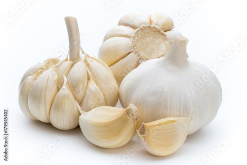 Fridge magnet Garlic isolated on the white background.