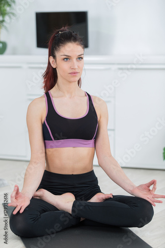 Poster beautiful girl is engaged in yoga