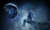 Spaceman on rock edge. Mixed media - 179359288
