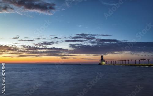 Fotobehang Vuurtoren Lighthouse at sunset sky on Lake Michigan, Indiana, USA