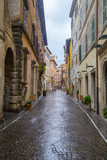 Old cobblestone street after rain