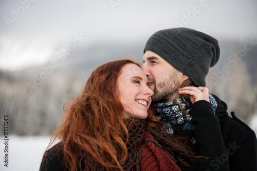 Plakat Bearded boyfriend kissing on his girlfriend's forehead