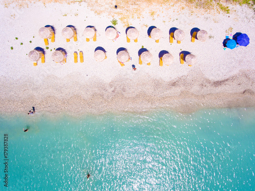 Foto op Plexiglas Cyprus Summer beach in Lefkada Greece with sun umbrellas and sunbeds and clear blue waters aerial view