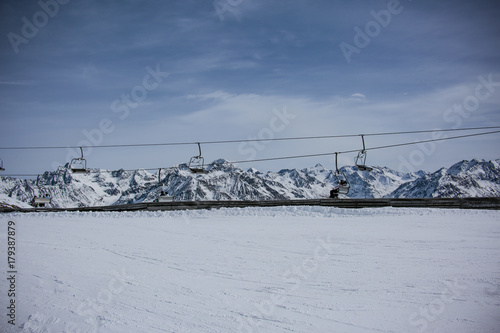 Foto op Plexiglas Donkergrijs Landscape of winter alpine mountains. Solden ski area. View of the glacier. Free space for your product or promotional text.