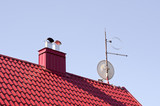 house red roof with chimney and TV disk