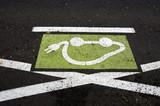 electromobile transport road sign on city asphalt