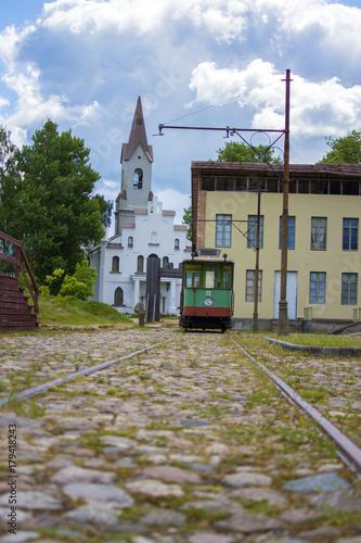 Retro tram on the street of old town © hivaka